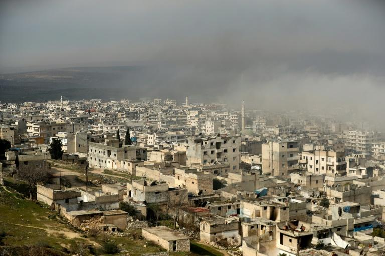 The rebel-held town of Ariha in the northern countryside of Syria's Idlib province following an air strike by pro-regime forces