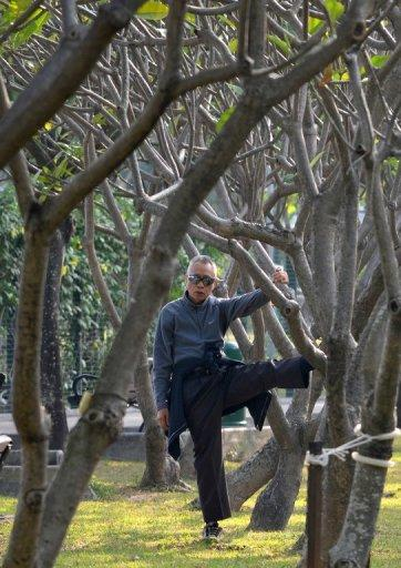 """An elderly man exercises in a park in Hong Kong. """"More leisure time physical activity was associated with longer life expectancy across a range of activity levels and BMI groups,"""" a study has concluded"""