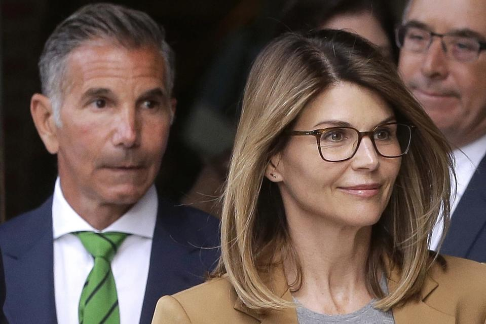 FILE - In this April 3, 2019, file photo, actress Lori Loughlin, front, and her husband, clothing designer Mossimo Giannulli, left, depart federal court in Boston after a hearing in a nationwide college admissions bribery scandal. A federal judge on Friday, May 8, 2020, refused to dismiss charges against the couple and other prominent parents accused of cheating in the college admissions process, siding with prosecutors who denied that investigators had fabricated evidence. (AP Photo/Steven Senne, File)