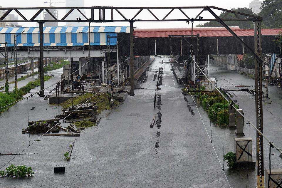 General view of the railway tracks flooded during a heavy monsoon rainfall in Mumbai on August 4, 2020. (Photo by SUJIT JAISWAL/AFP via Getty Images)