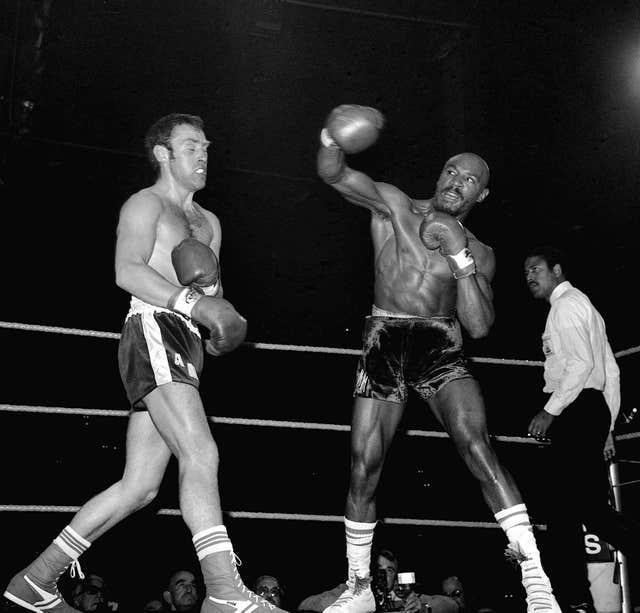 Marvin Hagler, right, defeated Alan Minter, left, to become world middleweight champion in 1980 (PA)