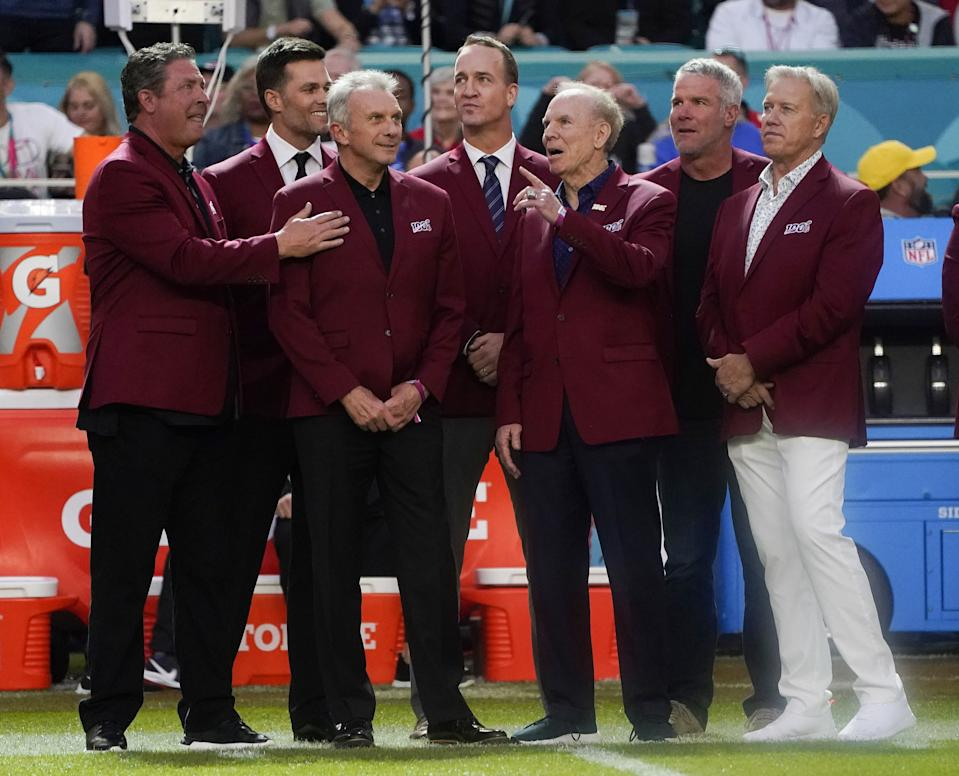 Dan Marino (L), Tom Brady (2L), Joe Montana (3L) Peyton Manning (4L), Roger Staubach (2R), Brett Favre (2R) and John Albert Elway Jr. (R) ahead of Super Bowl LIV between the Kansas City Chiefs and the San Francisco 49ers at Hard Rock Stadium in Miami Gardens, Florida, on February 2, 2020. (Photo by TIMOTHY A. CLARY/AFP via Getty Images)