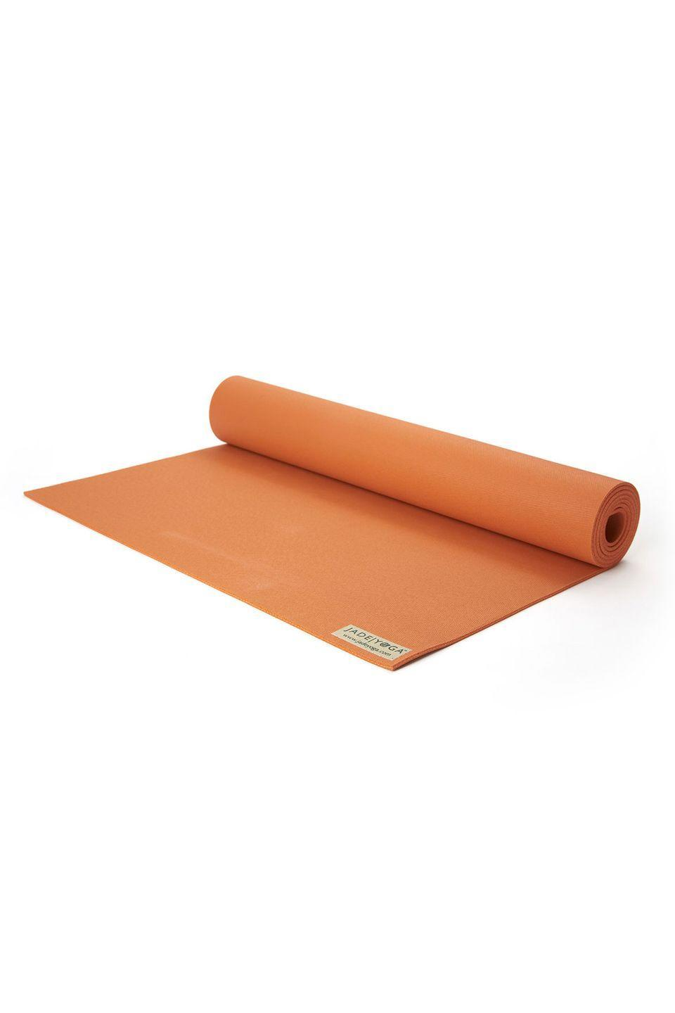"<p><a class=""link rapid-noclick-resp"" href=""https://go.redirectingat.com?id=127X1599956&url=https%3A%2F%2Fwww.greenyogashop.com%2Fen%2Fharmony-professional-orange-yoga-mat&sref=https%3A%2F%2Fwww.harpersbazaar.com%2Fuk%2Fbeauty%2Ffitness-wellbeing%2Fg32183508%2Fbest-yoga-mats%2F"" rel=""nofollow noopener"" target=""_blank"" data-ylk=""slk:SHOP NOW"">SHOP NOW</a></p><p>Made from natural, completely bio-degradable rubber, Jade Yoga's orange mat is a little different from your typical styles due to its open weave. This texture gives it an unrelenting grip, which holds up even when you have wet hands. If this wasn't enough to convince you, the business will plant a tree for every one bought.</p><p>Natural rubber yoga mat, £68.50, greenyogashop.com</p>"