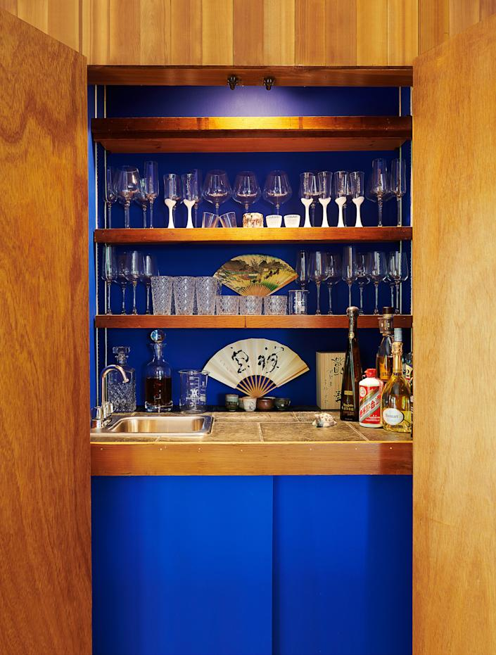 Vintage sake glasses and Japanese fans join Arsham's own designs in the wet bar.