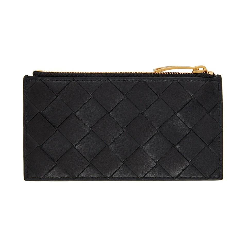 """If you're a fan of Bottega Veneta's woven handbags but aren't so into the prices, invest in what is essentially the miniature version for a fraction of the cost. $380, SSENSE. <a href=""""https://www.ssense.com/en-us/women/product/bottega-veneta/black-intrecciato-card-holder/6394821"""" rel=""""nofollow noopener"""" target=""""_blank"""" data-ylk=""""slk:Get it now!"""" class=""""link rapid-noclick-resp"""">Get it now!</a>"""