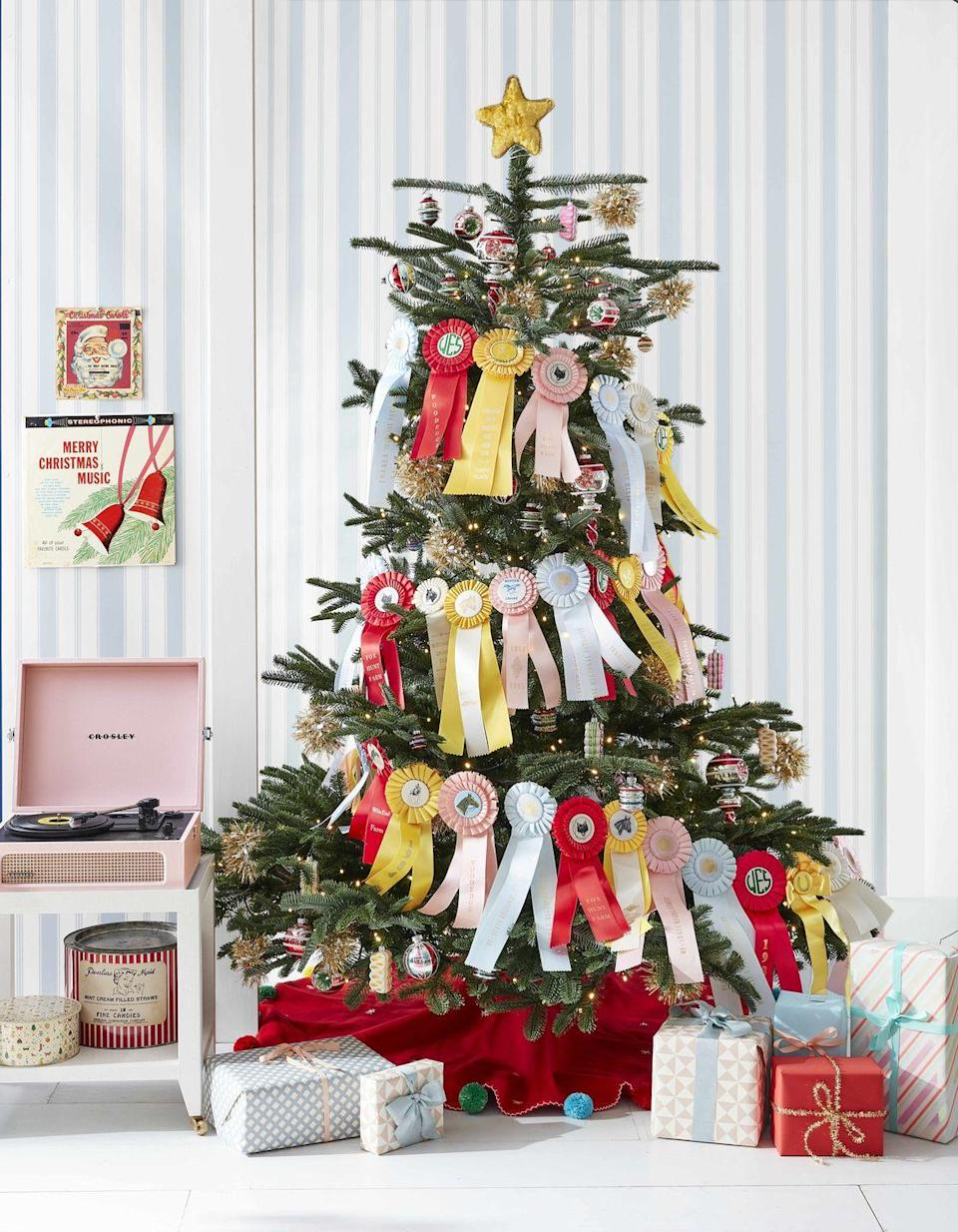 """<p>You can create a charming, first-rate garland by stringing together prize ribbons or other colorful collections (try pennants, scouting badges, or vintage travel tags) with floral wire. Choose a wide tree so that the garland will have space to stretch across, and coordinate your ribbon selection to match your existing Christmas decor.</p><p><a class=""""link rapid-noclick-resp"""" href=""""https://www.amazon.com/s?k=prize+ribbons&ref=nb_sb_noss_1&tag=syn-yahoo-20&ascsubtag=%5Bartid%7C10050.g.28703522%5Bsrc%7Cyahoo-us"""" rel=""""nofollow noopener"""" target=""""_blank"""" data-ylk=""""slk:SHOP PRIZE RIBBONS"""">SHOP PRIZE RIBBONS</a></p>"""