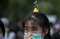 An anti-government protester wears a hair-pin with yellow ducks, a current symbol of the protest movement, during a rally Wednesday, Dec. 2, 2020, in Bangkok, Thailand. Thailand's highest court Wednesday acquitted Prime Minister Prayuth Chan-ocha of breaching ethics clauses in the country's constitution, allowing him to stay in his job. (AP Photo/Gemunu Amarasinghe)