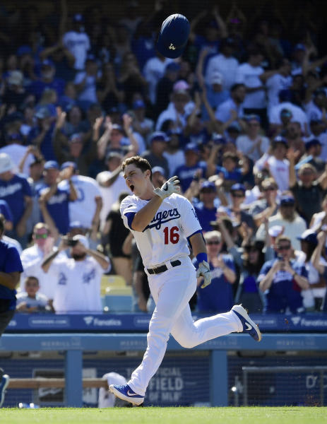 Los Angeles Dodgers' Will Smith tosses his helmet before scoring after hitting a two-run walkoff home run during the ninth inning of a baseball game against the Colorado Rockies, Sunday, June 23, 2019, in Los Angeles.  (AP Photo/Mark J. Terrill)