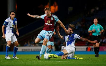 Football Soccer - Carabao Cup - Second Round - Blackburn Rovers vs Burnley - Blackburn, Britain - August 23, 2017   Burnley's Scott Arfield in action with Blackburn's Charlie Mulgrew   Action Images via Reuters/Craig Brough