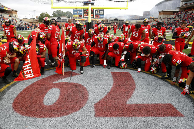 "Maryland players gather at a No. 79 painted on the field in remembrance of offensive lineman <a class=""link rapid-noclick-resp"" href=""/ncaab/players/144714/"" data-ylk=""slk:Jordan McNair"">Jordan McNair</a>, who died after collapsing on a practice field during a spring practice, before an NCAA college football game against Illinois, Saturday, Oct. 27, 2018, in College Park, Md. (AP Photo/Patrick Semansky)"