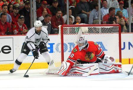 May 21, 2014; Chicago, IL, USA; Los Angeles Kings right wing Justin Williams (14) attempts a wrap around shot on Chicago Blackhawks goalie Corey Crawford (50) during the third period of game two of the Western Conference Final of the 2014 Stanley Cup Playoffs at the United Center. Dennis Wierzbicki-USA TODAY Sports