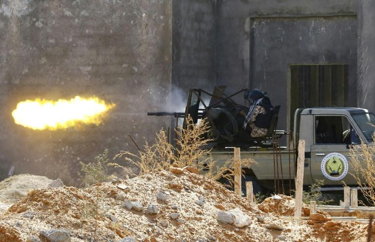 A fighter loyal to Libyan Government of National Accord (GNA)opens fire in clashes with forces loyal to strongman Khalifa Haftar in suburban Tripoli (AFP Photo/Mahmud TURKIA)