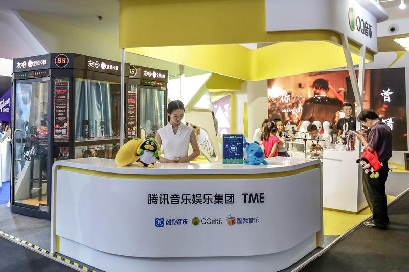 FILE PHOTO - Visitors are seen at a booth of Tencent Music Entertainment at the Beijing Music and Life Show in Beijing