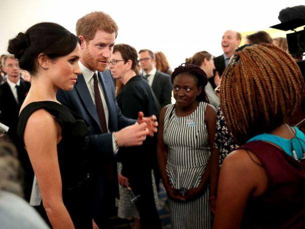 PHOTO: Meghan Markle and Prince Harry speaks with guests as they attend the Women's Empowerment reception at the Royal Aeronautical Society, April 19, 2018, in London. (Chris Jackson/Getty Images)