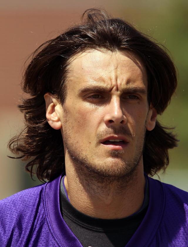 FILE - This is a July 28, 2012 file photo showing Minnesota Vikings punter Chris Kluwe at NFL football training camp in Mankato, Minn. The Vikings have retained a former chief justice of the Minnesota Supreme Court and a former federal trial attorney to conduct an investigation into Kluwe's allegations that he was released from the team due to his support of gay marriage. The team made the announcement on Friday, , Jan. 3, 2014, one day after Kluwe penned a scathing article alleging that special teams coordinator Mike Priefer made anti-gay comments during team meetings. (AP Photo/Genevieve Ross, File)