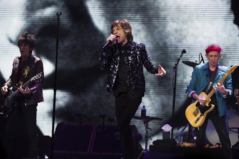 FILE - This Dec. 8, 2012 file photo shows Ronnie Wood, from left, Mick Jagger and Keith Richards of The Rolling Stones performing in New York. The band is expected to release information on their upcoming tour on Wednesday, April 3, 2013. (Photo by Charles Sykes/Invision/AP, file)