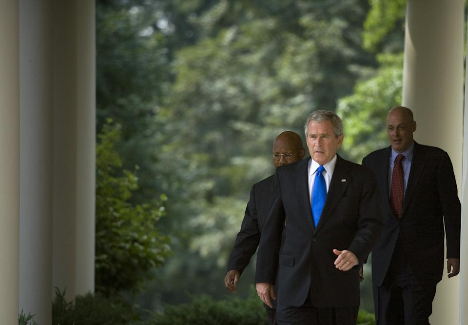 WASHINGTON - AUGUST 31:  U.S. President George W. Bush walks to the Rose Garden of the White House with Secretary of the United States Department of Housing and Urban Development Alphonso Jackson (L) and Secretary of the Treasury Henry M. Paulson Jr. (R) August 31, 2007 in Washington, DC.  Joined by Secretary of the Treasury Henry M. Paulson Jr. and Alphonso Jackson, Secretary of the United States Department of Housing and Urban Development, President Bush spoke about the defaulting home loan crisis and the economy.  (Photo by Brendan Smialowski/Getty Images)