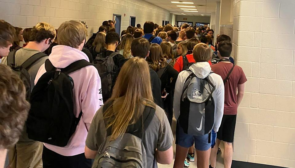 In this photo posted on Twitter, students crowd a hallway, Tuesday, Aug. 4, 2020, at North Paulding High School in Dallas, Ga. The 30,000-student suburban Paulding County school district in suburban Atlanta resumed classes Monday with 70% of students returning for in-person classes five days a week, days after the principal at North Paulding announced some members of the football team had tested positive for COVID-19.