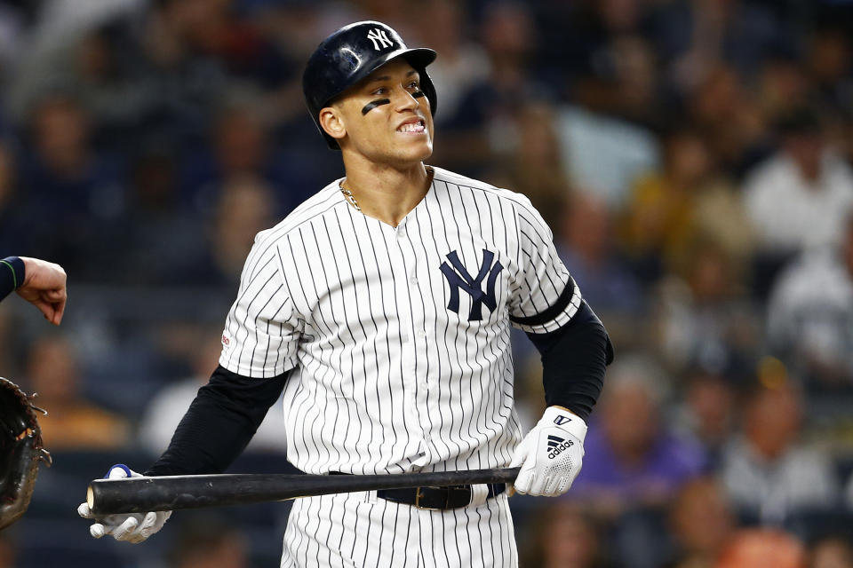 Aug 15, 2019; Bronx, NY, USA; New York Yankees right fielder Aaron Judge (99) reacts to striking out against the Cleveland Indians during the fifth inning at Yankee Stadium. Mandatory Credit: Adam Hunger-USA TODAY Sports