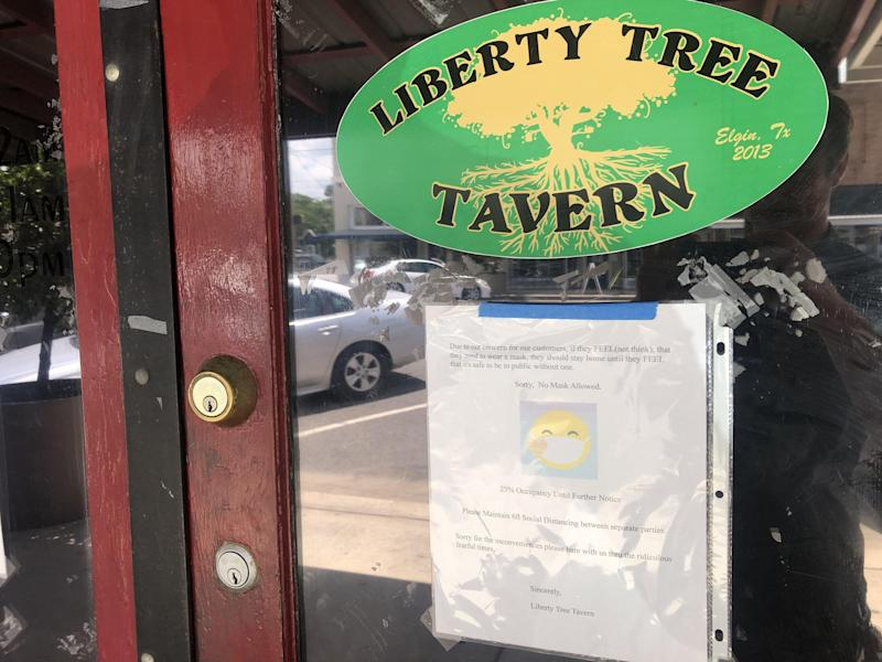 The Liberty Tree Tavern in downtown Elgin has posted a sign outside its entrance saying that anyone wearing a mask will not be allowed in.