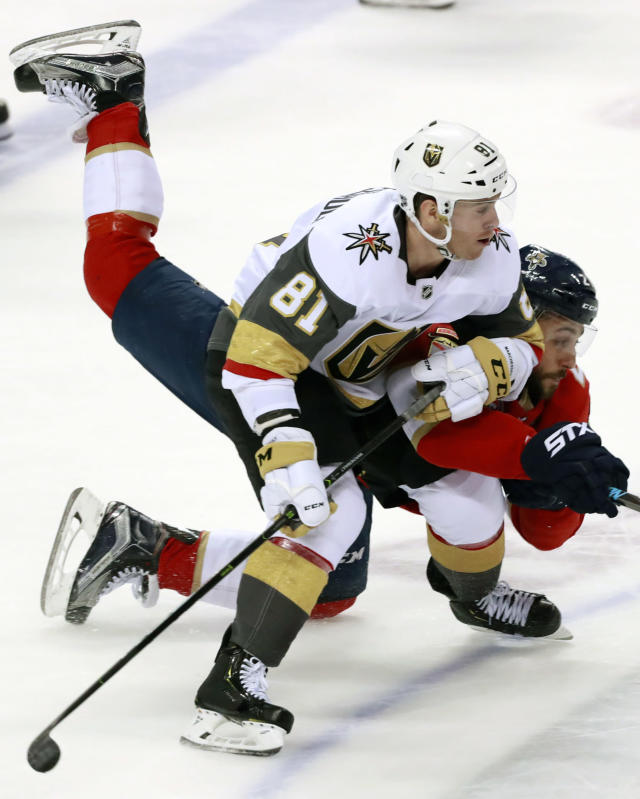Vegas Golden Knights center Jonathan Marchessault (81) and Florida Panthers center Vincent Trocheck battle for the puck during the second period of an NHL hockey game, Saturday, Feb. 2, 2019, in Sunrise, Fla. (AP Photo/Wilfredo Lee)