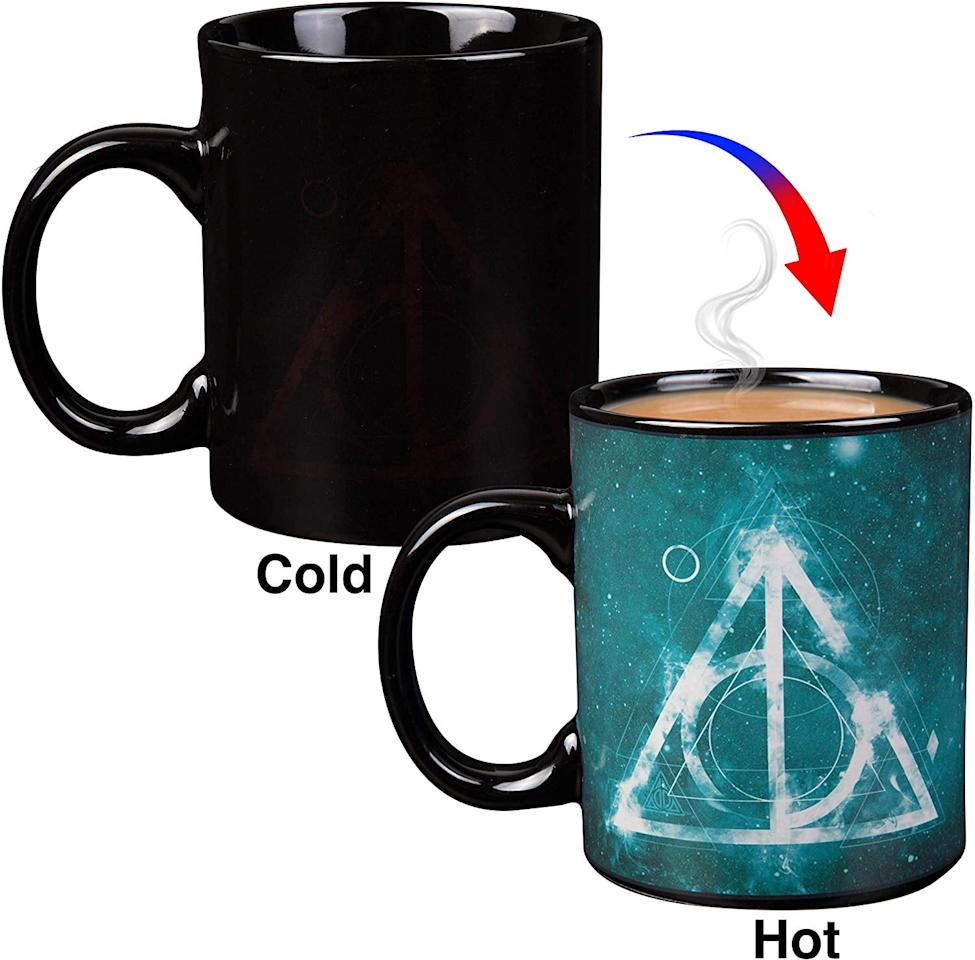 "<p>The magic begins when you pour a hot beverage into this <a href=""https://www.popsugar.com/buy/Harry-Potter-Heat-Reveal-Ceramic-Coffee-Mug-512270?p_name=Harry%20Potter%20Heat%20Reveal%20Ceramic%20Coffee%20Mug&retailer=amazon.com&pid=512270&price=14&evar1=moms%3Aus&evar9=44308327&evar98=https%3A%2F%2Fwww.popsugar.com%2Fphoto-gallery%2F44308327%2Fimage%2F46856874%2FHarry-Potter-Heat-Reveal-Ceramic-Coffee-Mug&list1=amazon%2Choliday%2Cstocking%20stuffers%2Cchristmas%2Cgift%20guide%2Charry%20potter%2Cgifts%20under%20%2425%2Cgifts%20for%20women%2Cgifts%20for%20men%2Cgifts%20under%20%24100%2Cgifts%20under%20%2450%2Cgifts%20under%20%2475%2Cgifts%20for%20teens%2Ctrending%20gifts&prop13=api&pdata=1"" rel=""nofollow"" data-shoppable-link=""1"" target=""_blank"" class=""ga-track"" data-ga-category=""Related"" data-ga-label=""https://www.amazon.com/Harry-Potter-Reveal-Ceramic-Coffee/dp/B07TS8ZZFL/ref=sxin_2_ac_d_rm?ac_md=2-2-aGFycnkgcG90dGVyIGNvZmZlZSBtdWc%3D-ac_d_rm&amp;crid=23OGHDL4SCUWJ&amp;keywords=harry+potter+gifts+for+women&amp;pd_rd_i=B07TS8ZZFL&amp;pd_rd_r=4c0379c1-d45e-4d39-8544-b8656c7dc3c2&amp;pd_rd_w=5gngN&amp;pd_rd_wg=pTleM&amp;pf_rd_p=ed481207-4bea-4e19-bbad-73ed40fdc292&amp;pf_rd_r=YXP9M3W1XP8FT44GSH2Z&amp;psc=1&amp;qid=1572997110&amp;sprefix=harry+potter+gifts%2Caps%2C258"" data-ga-action=""In-Line Links"">Harry Potter Heat Reveal Ceramic Coffee Mug</a> ($14).</p>"