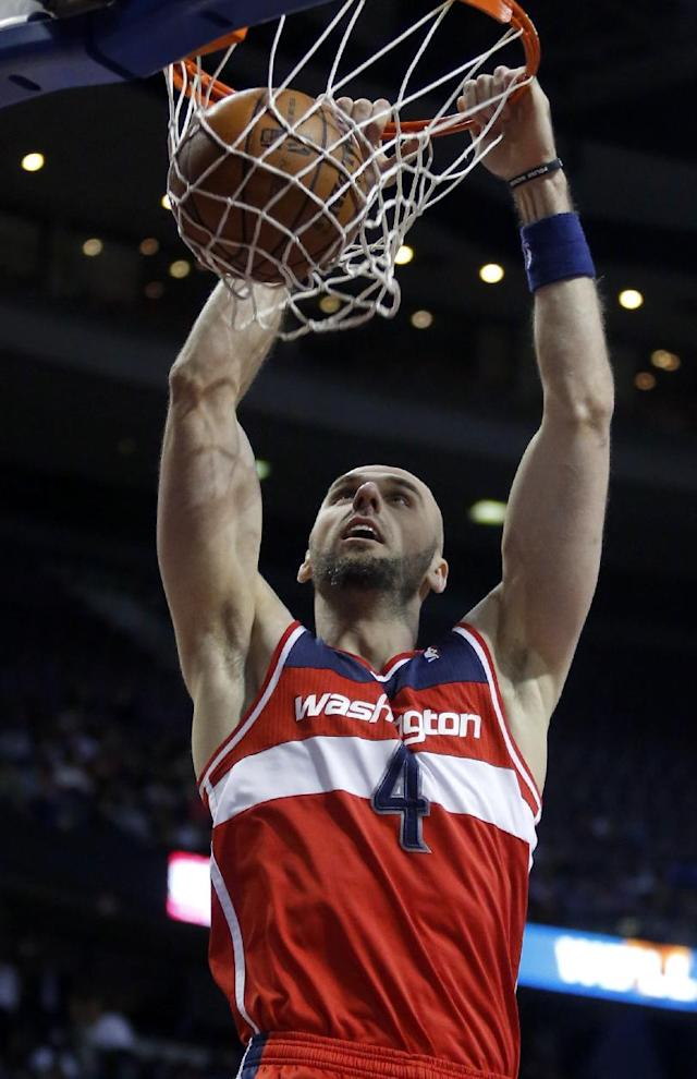 Washington Wizards center Marcin Gortat (4) dunks against the Detroit Pistons during the first half of an NBA basketball game, Monday, Dec. 30, 2013, in Auburn Hills, Mich. (AP Photo/Duane Burleson)