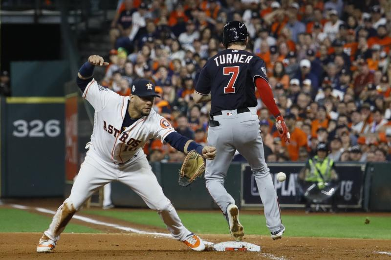 Washington Nationals' Trea Turner knocks the glove away from Houston Astros' Yuli Gurriel during the seventh inning of Game 6 of the baseball World Series Tuesday, Oct. 29, 2019, in Houston. (AP Photo/Matt Slocum)