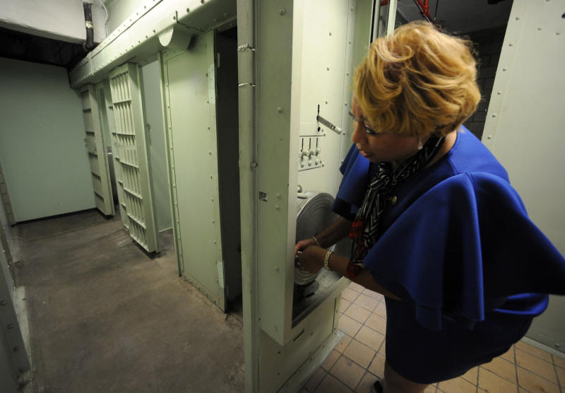 In this Friday, Jan. 10, 2020 photo, Jefferson County Commissioner Lashunda Roberts-Scales cranks the door mechanism at the old county jail in Birmingham, Ala. The county is taking steps to preserve the lockup, where officials say Dr. Martin Luther King Jr. served his final stint behind bars in 1967 about five months before his assassination. (AP Photo/Jay Reeves)