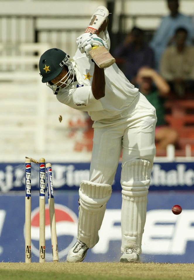 SHARJAH - OCTOBER 11:  Danish Kaneria of Pakistan is bowled by Brett Lee of Australia for eight during day one of the Second Test match between Pakistan and Australia played at Sharjah International Cricket Stadium in Sharjah, United Arab Emirates on October 11, 2002. (Photo by Hamish Blair/Getty Images)