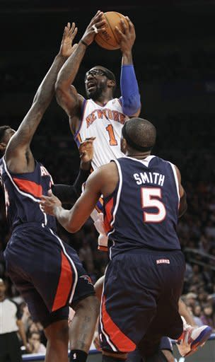 New York Knicks forward Amare Stoudemire (1) shoots over Atlanta Hawks forward Marvin Williams (24) as Hawks forward Josh Smith (5) watches in the first half of an NBA basketball game at Madison Square Garden in New York, Wednesday, Feb. 22, 2012. (AP Photo/Kathy Willens)