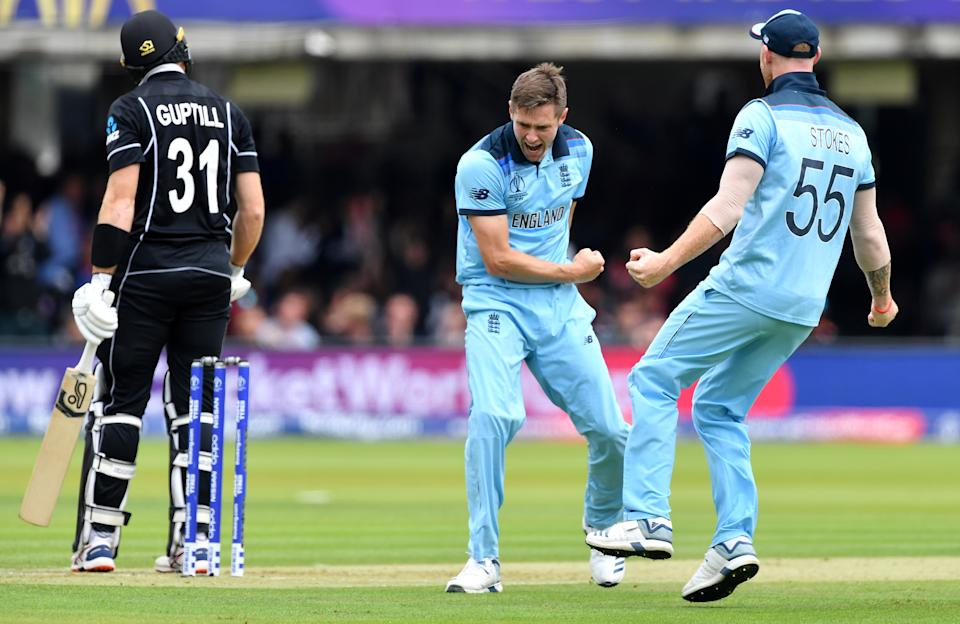England's Chris Woakes celebrates with Ben Stokes after Guptill fails to overturn his decision with a review (Photo by Paul ELLIS / AFP)