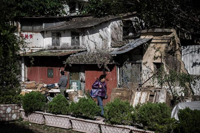 Nga Tsin Wai village, an ancient settlement in the heart of bustling Kowloon, will be demolished as part of a city re-urbanisation plan in Hong Kong (AFP Photo/Philippe Lopez)