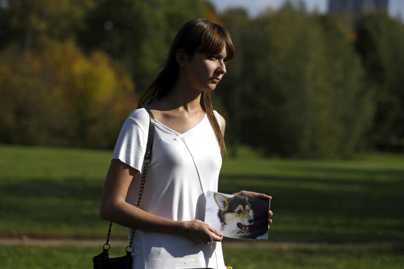 In this Thursday Sept. 20, 2012 photo Vera Lesovets holds a picture of her dead dog, five-year-old Yasha, who was killed in a mass poisoning of dogs in a Moscow park. Yasha's life was cut short last week: after snacking on something in a nearby park, she fell into a seizure at Lesovets's apartment and began foaming at the mouth. The family rushed her to a nearby veterinary clinic, where the veterinarian said this was the sixth case he had seen that week, and there was nothing he could do. On Friday, Sept. 21, 2012, police opened a criminal probe into the suspected poisoning of animals by dog killers, the latest such incident in Russia where cruelty to animals is common and animal protection laws are rarely enforced. (AP Photo/Sergey Ponomarev)