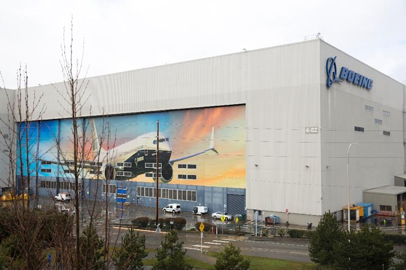 An image of a Boeing 737 MAX 8 is pictured on the exterior of the Boeing Renton Factory in Renton, Washington (AFP Photo/Jason Redmond)