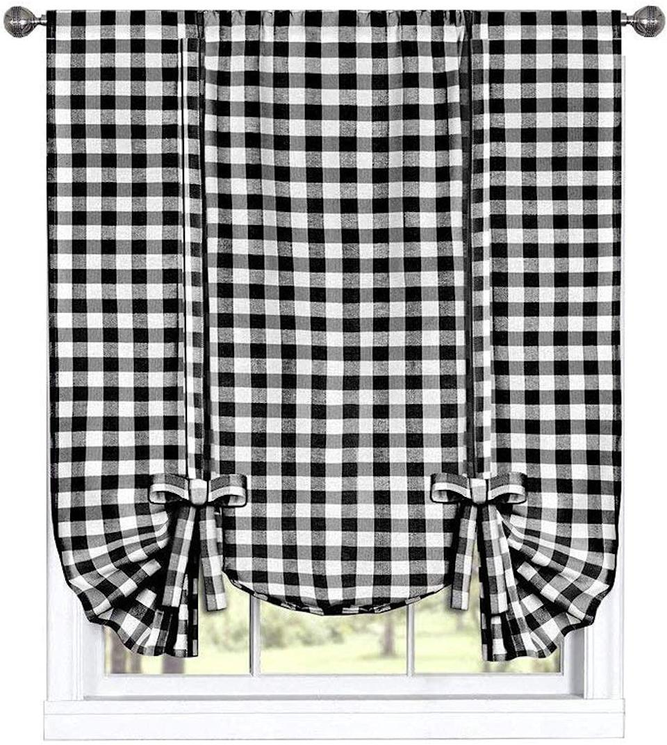 """When you think of farmhouse style, gingham is probably one of the first things you imagine. These top-rated gingham curtains come ready to hang and are machine washable. <a href=""""https://amzn.to/3dIgpVl"""" target=""""_blank"""" rel=""""noopener noreferrer"""">Find it for $20 at Amazon</a>."""
