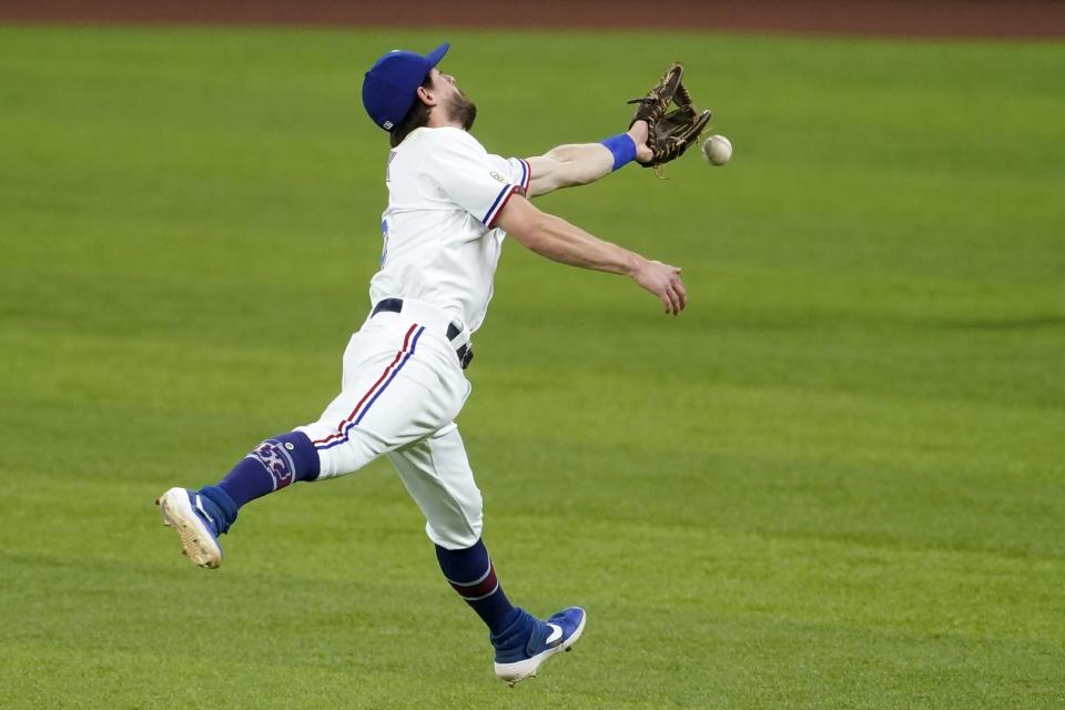 Texas Rangers second baseman Nick Solak is unable to reach a single hit by Houston Astros' Jose Altuve in the seventh inning of a baseball game in Arlington, Texas, Wednesday, Sept. 15, 2021. (AP Photo/Tony Gutierrez)