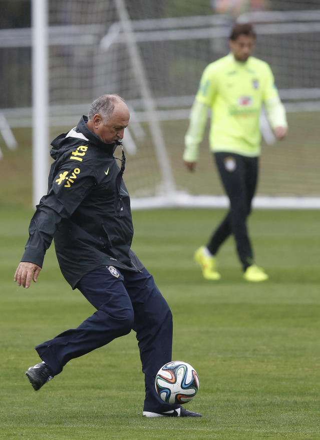 Brazil coach Luiz Felipe Scolari kicks the ball during a practice session at the Granja Comary training center in Teresopolis, Brazil, Friday, July 11, 2014. Brazil will face the Netherlands in the World Cup third-place match Saturday. (AP Photo/Leo Correa)
