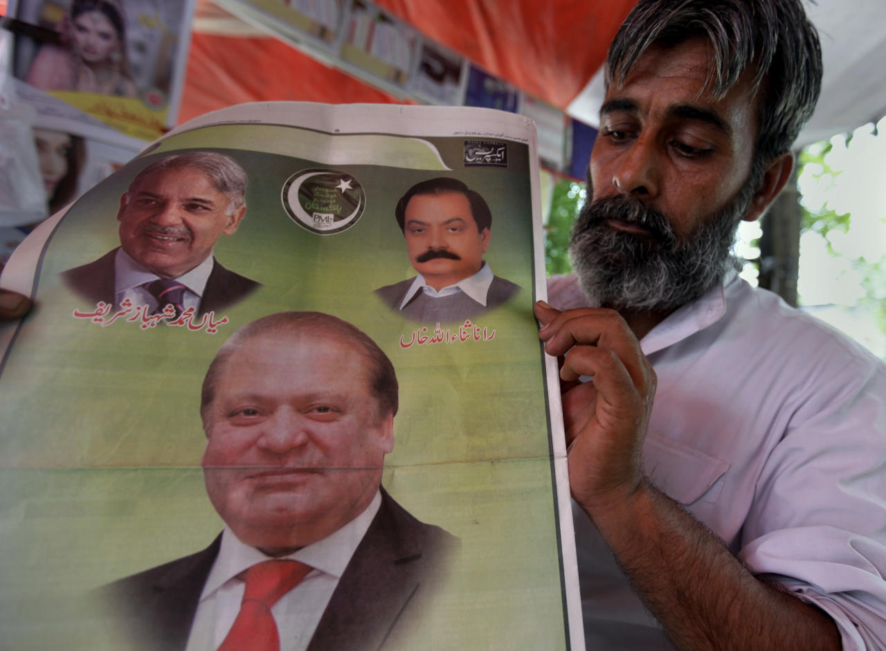 A man holds a special edition of a morning newspaper displaying the deposed Prime Minister Nawaz Sharif at a news stall in Islamabad, Pakistan, Saturday, July 29, 2017. A top leader from the ruling party of deposed Prime Minister Sharif says a meeting of the party's lawmakers has been convened to consider who will be the country's next premier. (AP Photo/Anjum Naveed)