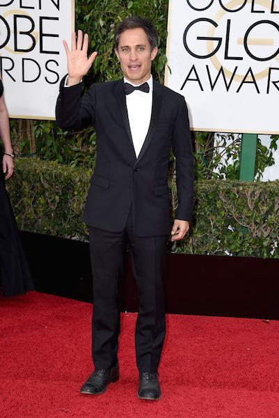 Gael Garcia Bernal in classic black and sporting some salt and pepper hair at the 73rd Golden Globe Awards.