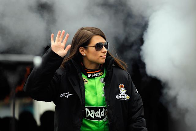 DAYTONA BEACH, FL - FEBRUARY 26: Danica Patrick, driver of the #10 GoDaddy.com Chevrolet, waves to fans during driver introductions prior to the start of the NASCAR Sprint Cup Series Daytona 500 at Daytona International Speedway on February 26, 2012 in Daytona Beach, Florida. (Photo by Streeter Lecka/Getty Images)