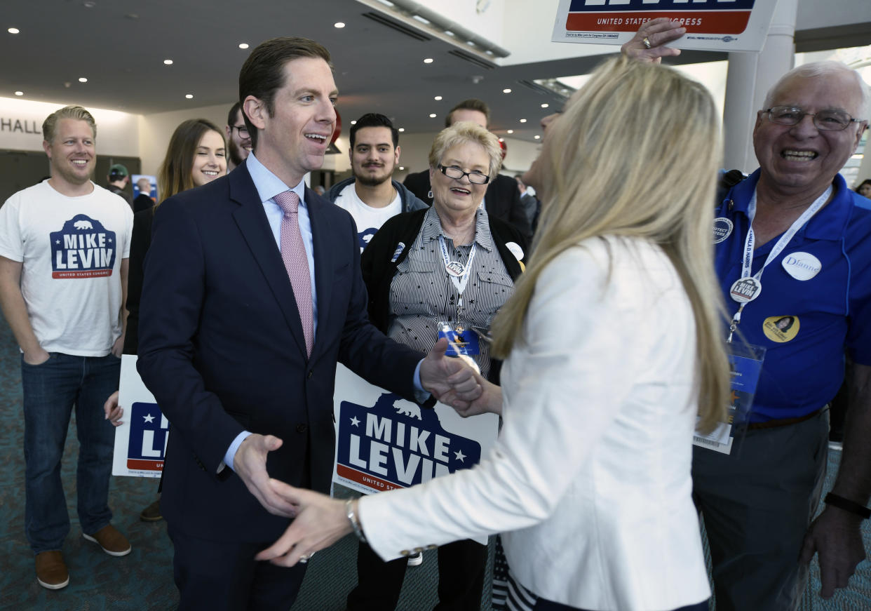 Democratic congressional candidate Mike Levin with his wife, Chrissy, in front of supporters at the 2018 California Democratic State Convention, on Feb. 24 in San Diego. (Photo: Denis Poroy/AP)