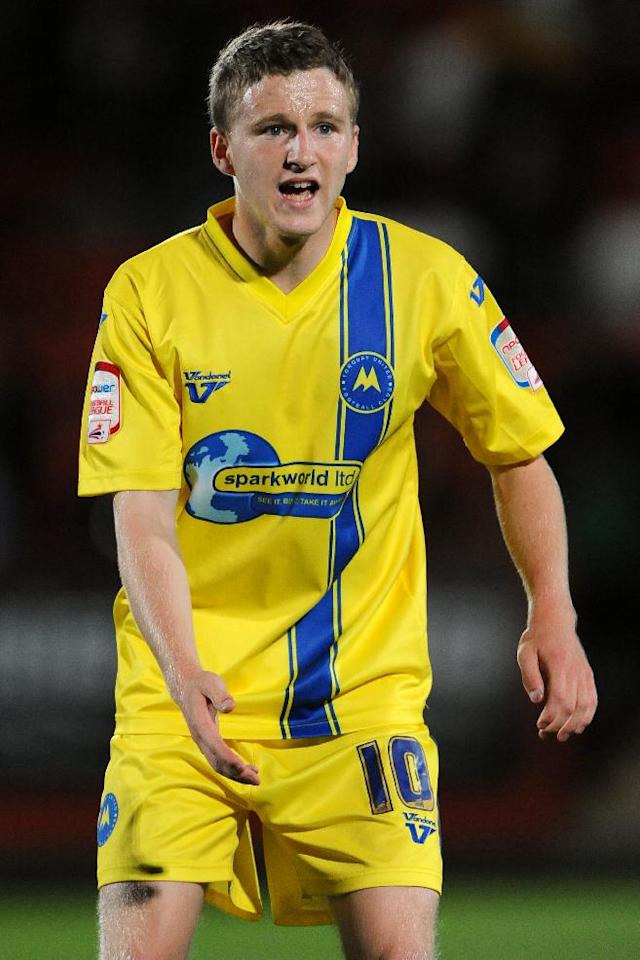 Crawley have made an approach for Torquay midfielder Eunan O'Kane