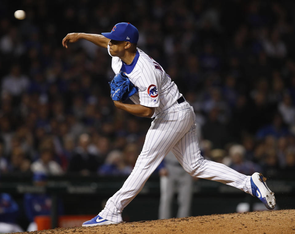Chicago Cubs' Adbert Alzolay pitches against the New York Mets during the eighth inning of a baseball game, in his debut in the majors, Thursday, June 20, 2019, in Chicago. (AP Photo/Jim Young)