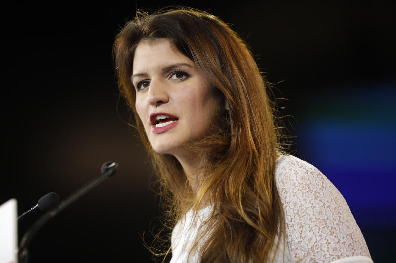 FILE - In this Nov. 18, 2017 file photo, French secretary of state for women's rights Marlene Schiappa delivers a speech in Chassieu, near Lyon, central France.  Twelve women, journalists and witnesses go on trial Monday Feb. 4, 2019, for alleged defamation of prominent French lawmaker Denis Baupin after their accusations of sexual misconduct forced his resignation, although Baupin denied any misconduct, and Marlene Schiappa has said she would not specifically comment on the case because it's up to justice to decide. (AP Photo/Laurent Cipriani, File)