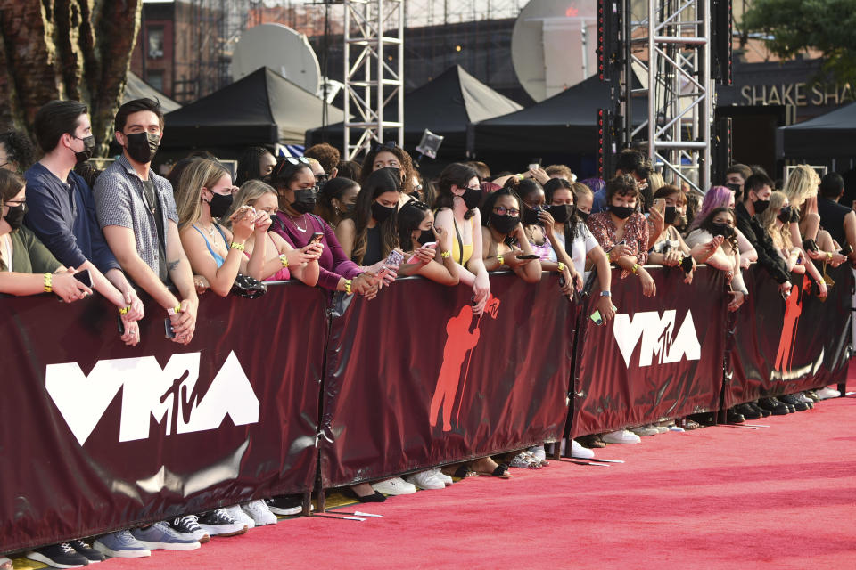 Fans wearing masks line up along the red carpet at the MTV Video Music Awards at Barclays Center on Sunday, Sept. 12, 2021, in New York. (Photo by Evan Agostini/Invision/AP)