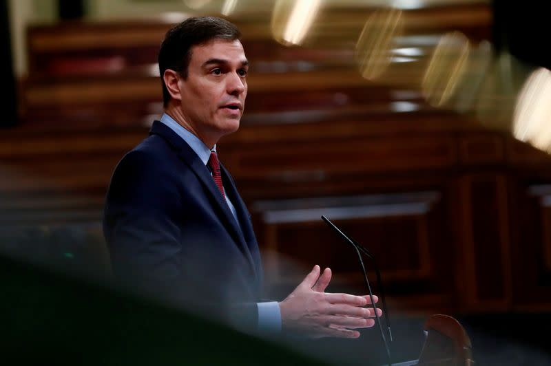 Spanish PM Sanchez delivers during a session on coronavirus disease (COVID-19) at Parliament in Madrid