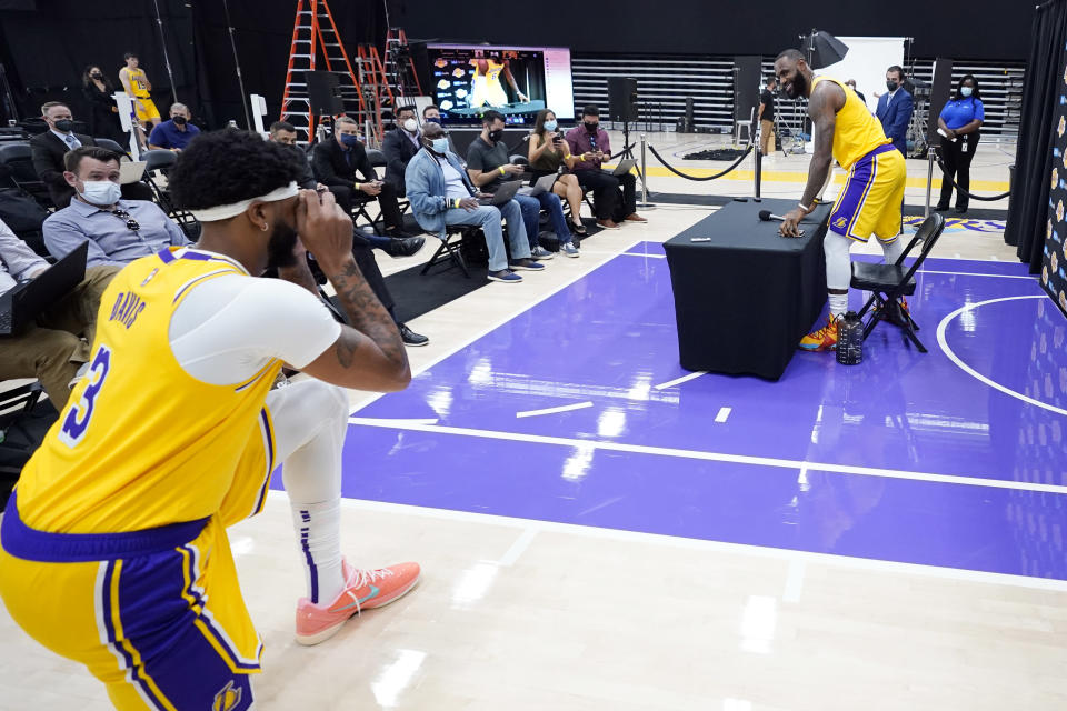 Los Angeles Lakers forward LeBron James, right, has his photo taken by teammate Anthony Davis during the NBA basketball team's Media Day Tuesday, Sept. 28, 2021, in El Segundo, Calif. (AP Photo/Marcio Jose Sanchez)