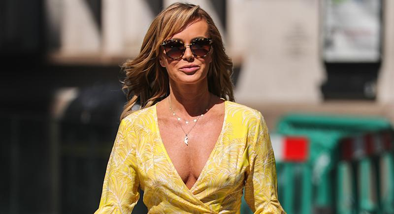 Amanda Holden wears Beach Cafe yellow printed Cheryl dresstohost Heart radio. (Getty Images)