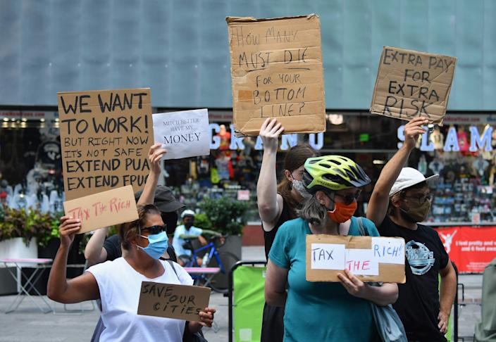 Protesters demand economic relief at New York's Time Square on Aug. 5. President Joe Biden has signed an executive order extending an eviction moratorium, but policy analysts have said loopholes do not universally protect tenants.